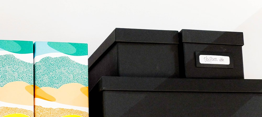 Multicolor and black organizational boxes